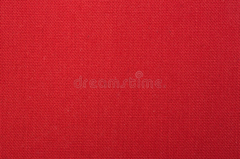 Red Woven Fabric Texture Background. Background texture of coarse woven red fabric royalty free stock photography