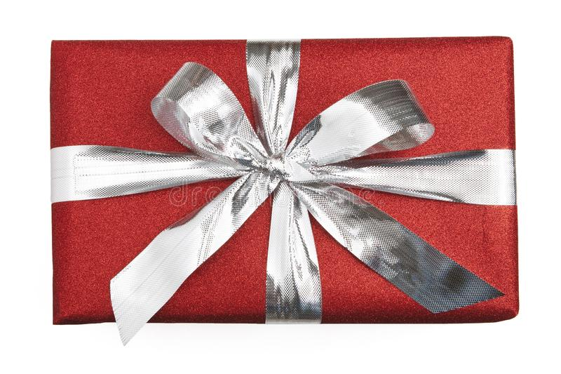 Red wrapped gift with a silver ribbon stock photography
