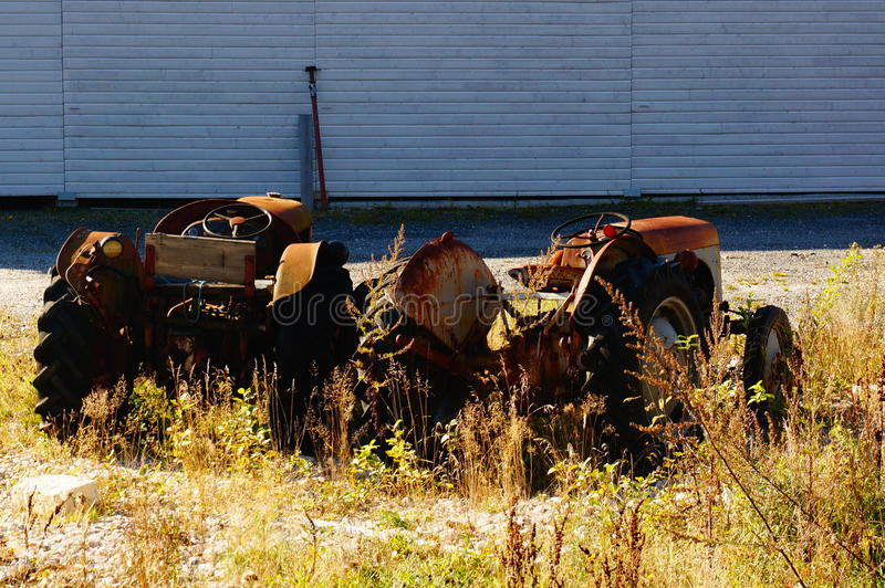 Red wrecked tracktor in parking, Norway royalty free stock photography