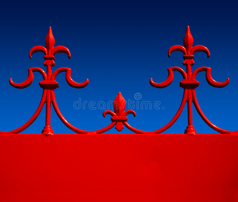 Red wrought iron fleur de lys against graduated bl. Ue sky. Bright.striking, victorian architectural motif against a vivid blue sky. From a building in a British vector illustration