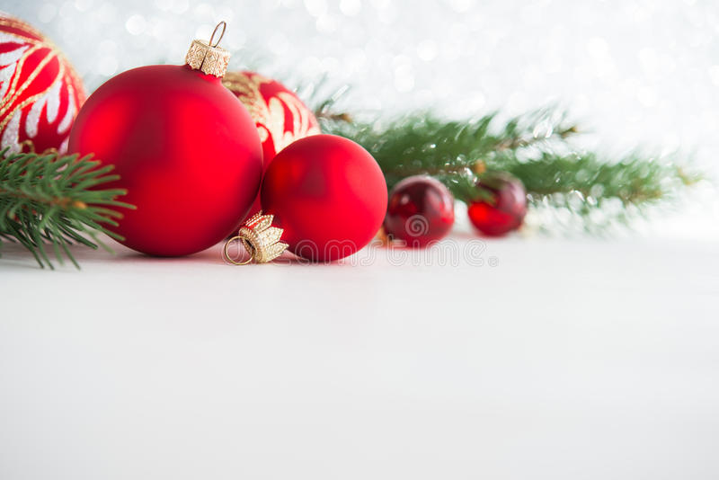 Red xmas ornaments on wooden background. Merry christmas card. stock images