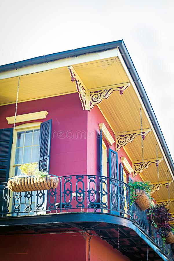 Red and yello house corner in New Orleans French Quarter royalty free stock photography