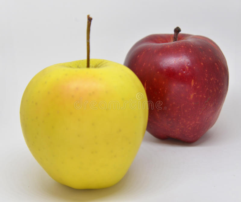 Red yellow apple with green royalty free stock photography