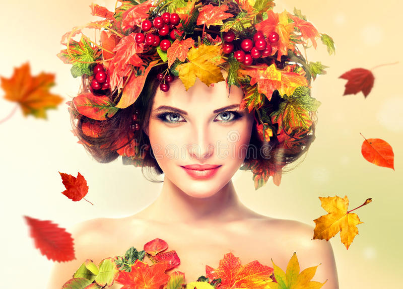 Red and yellow autumn Leaves on girl head. stock images