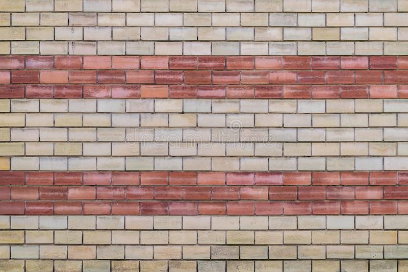 Red and yellow brick wall texture stock image