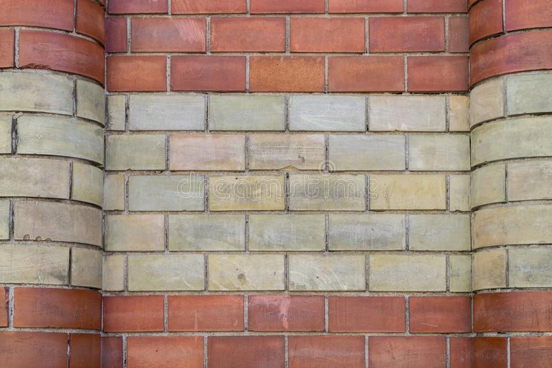 Red and yellow brick wall texture stock photo
