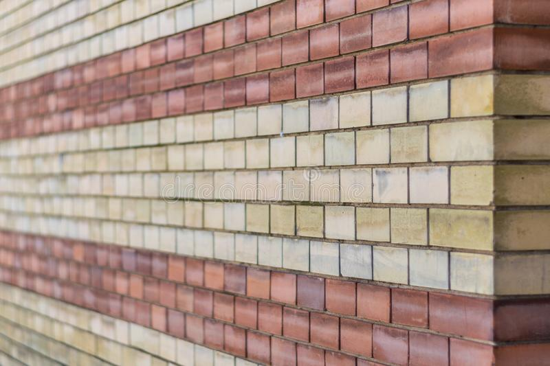 Red and yellow brick wall texture stock photography