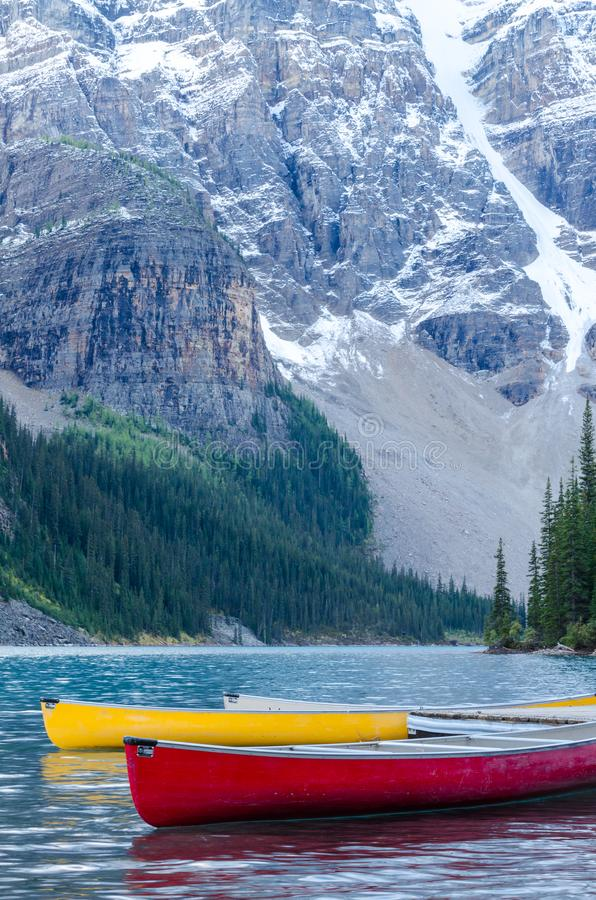 Red and yellow canoes on Moraine Lake stock photo
