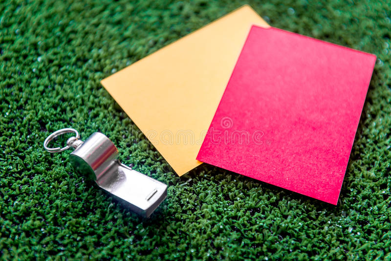 Red and yellow cards on green background close up. Mock up royalty free stock photography
