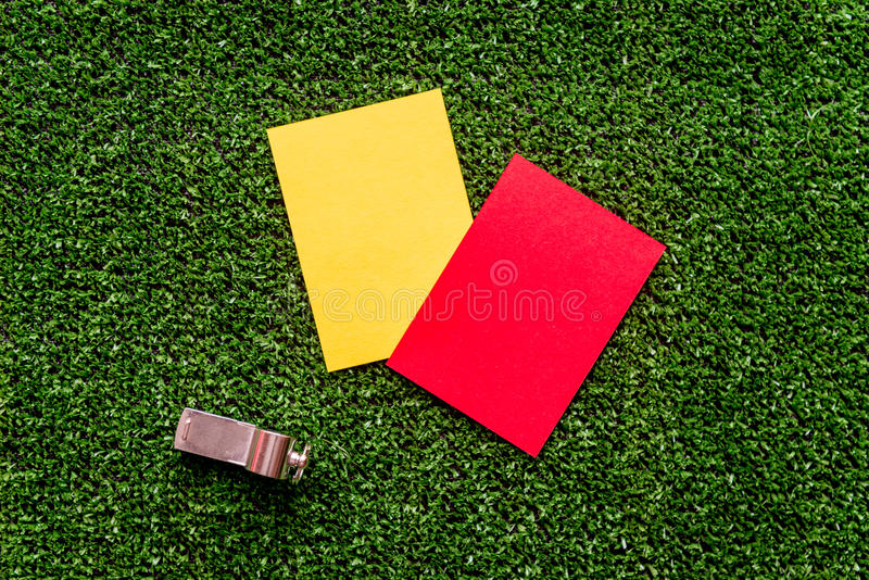 Red and yellow cards on green background top view. Mock up royalty free stock images