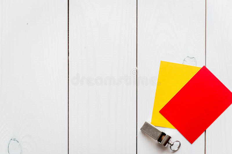 Red and yellow cards on wooden background top view. Mock up stock images