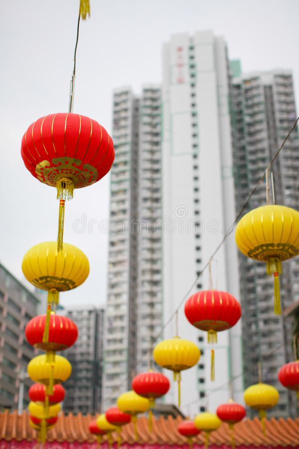 Red and yellow Chinese lanterns on a background of white skyscrapers. concept of contrast of old traditions and modern world stock photos