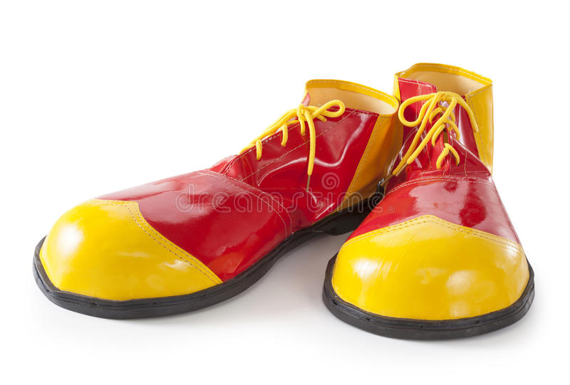 Red and yellow clown shoes royalty free stock image