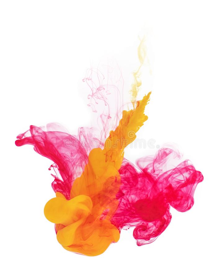 Red and yellow color paint pouring. stock images