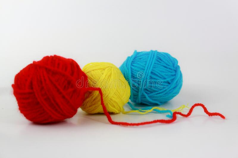 Red, yellow and cyan yarn closeup isolated on white background royalty free stock image