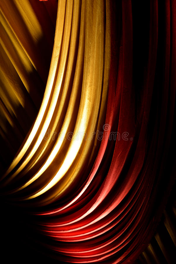 Red & yellow drapes or curtains on a stage stock photography