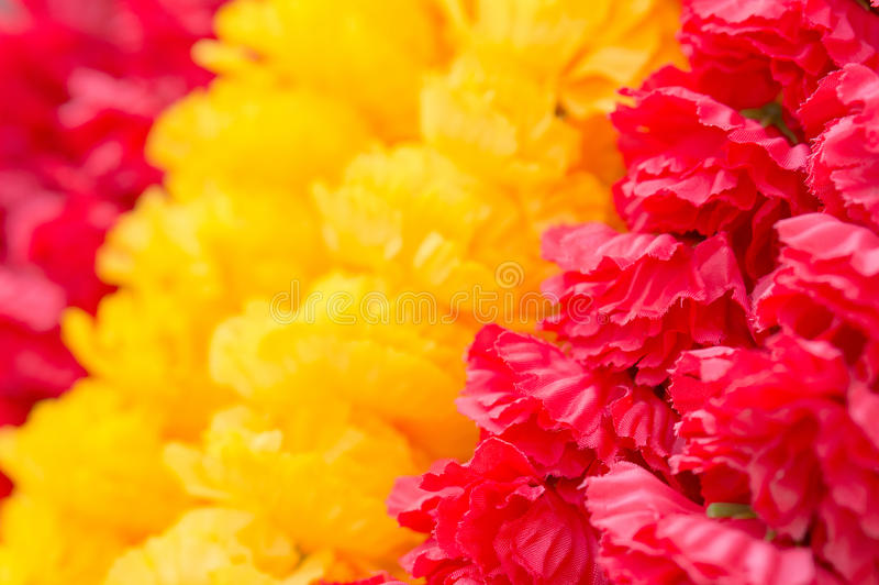 Red and yellow fabric flower stripe stock image