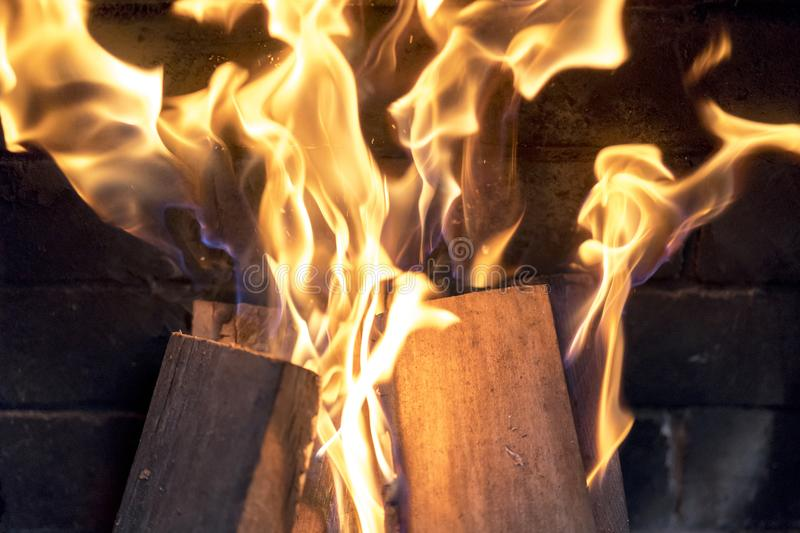 red yellow fire in the fireplace close-up. flames. Fire background stock photography