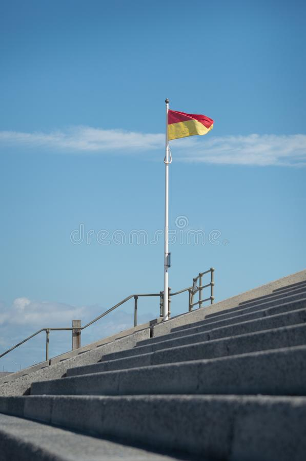 Red and yellow flag on steps stock image