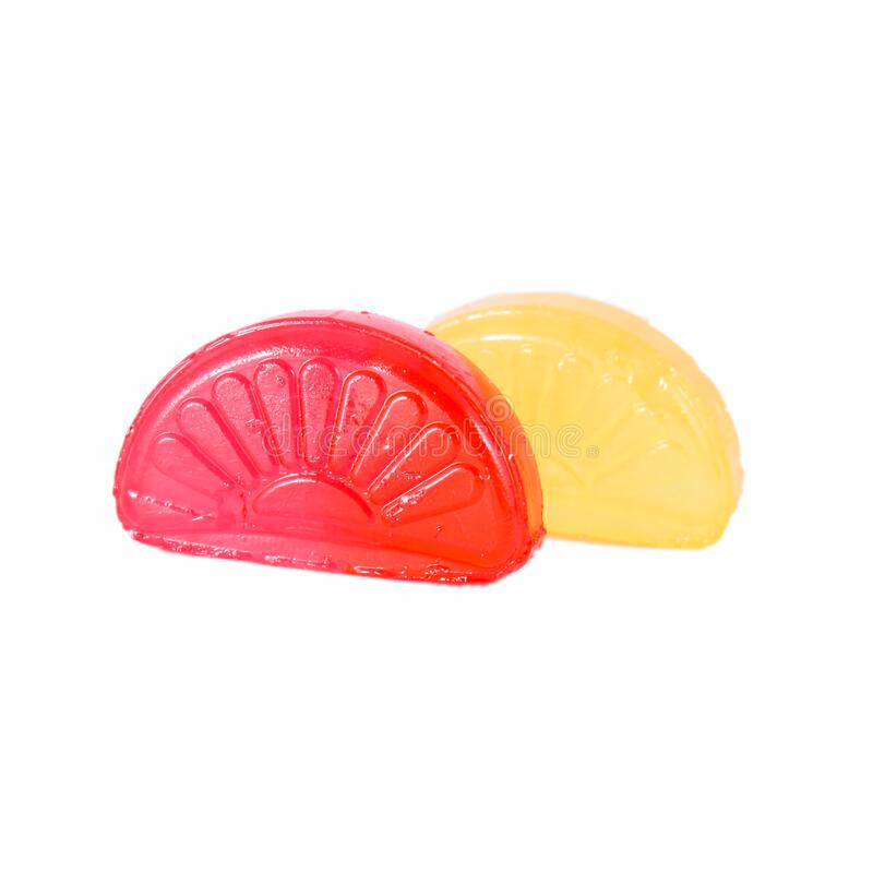 Red and yellow fruit candies. Red and yellow fruit  candies on white background stock photography