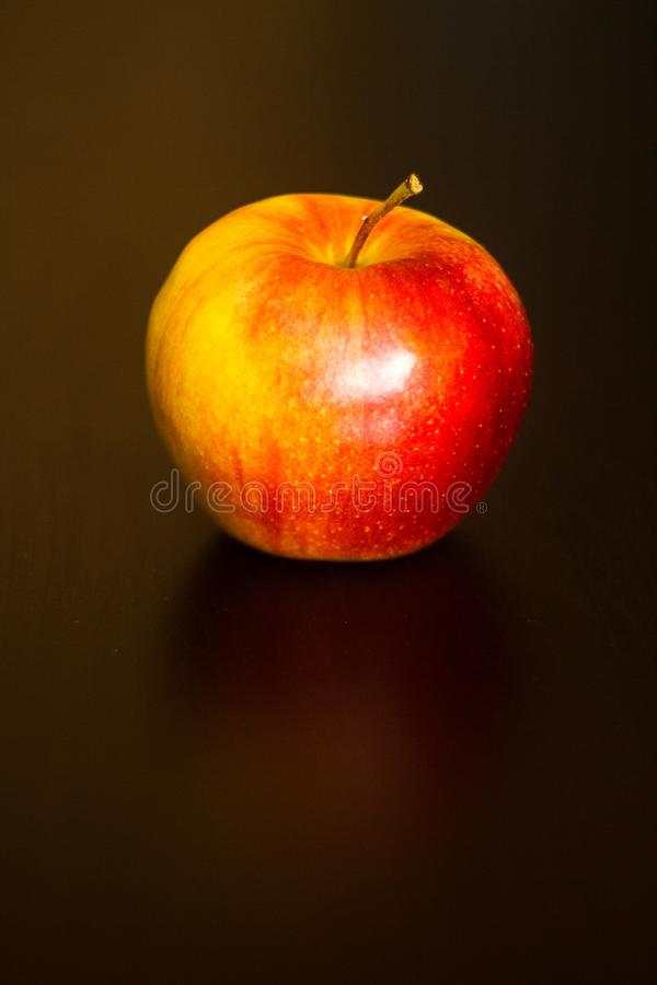 Red apple on black table royalty free stock photos