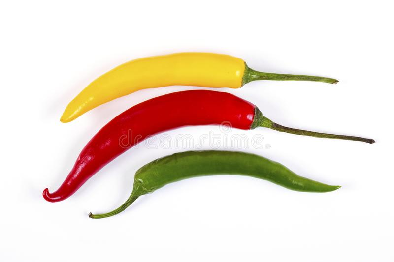 Red, yellow and green hot pepper. Macro shot royalty free stock photos