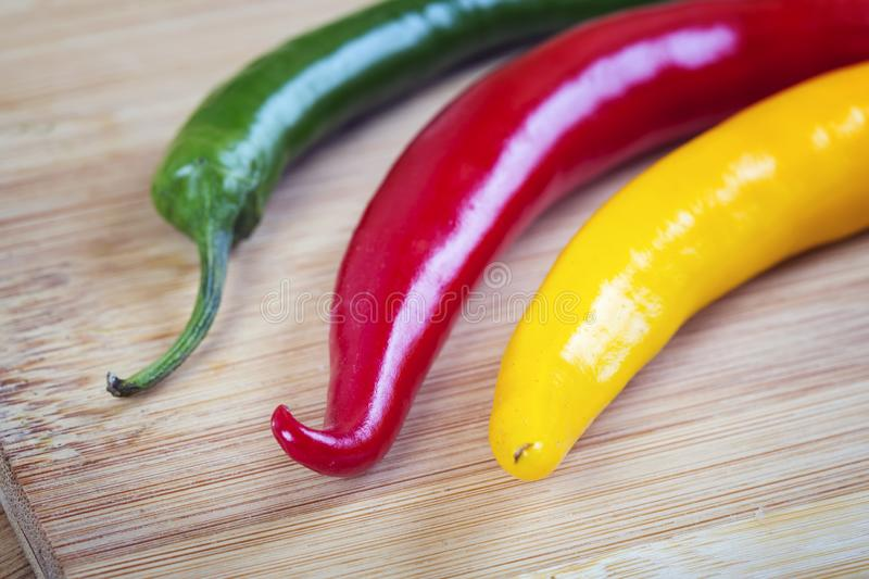 Red, yellow and green hot pepper. Macro shot stock photos