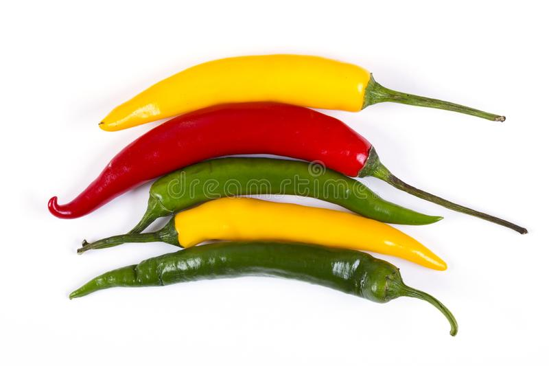 Red, yellow and green hot pepper. Macro shot royalty free stock image