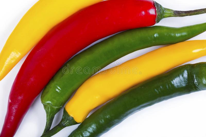Red, yellow and green hot pepper. Macro shot stock image