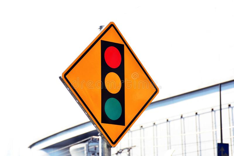 Red yellow and green sign label of traffic light on the road in the city. royalty free stock photo