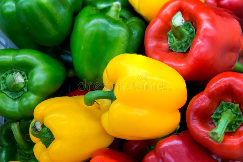 Red and yellow and Green sweet peppers. Pile Three sweet peppers on a wooden background, Cooking vegetable salad . stock photography
