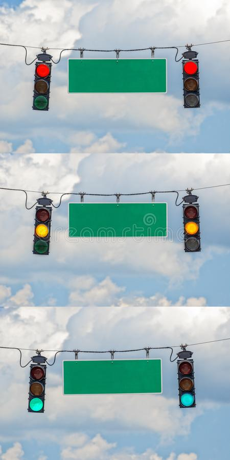 Red, Yellow, and Green Traffic Lights With Blank Street Signs stock images