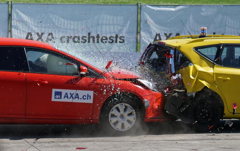 Red and Yellow Hatchback Axa Crash Tests stock photos