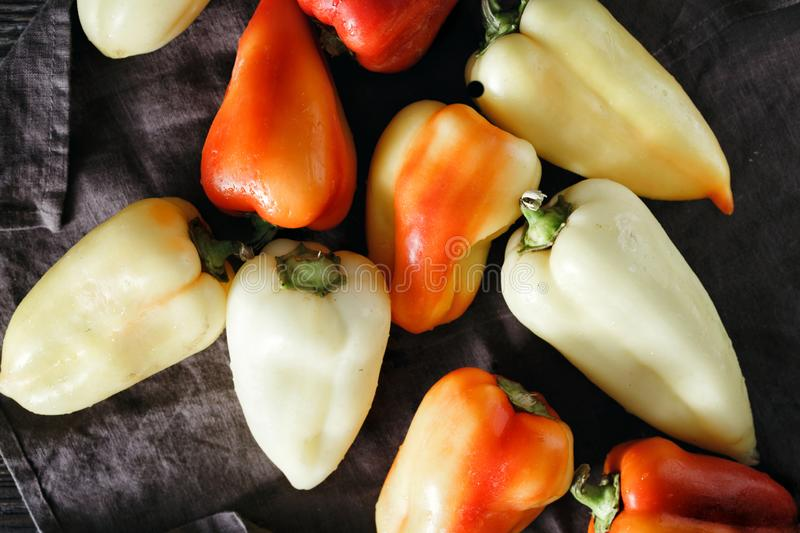 Red yellow homemade pepper dark background top view stock photography