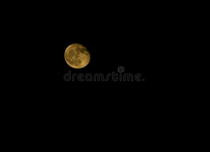 A red yellow moon on a clear night. A red yellow moon on a clear summer night with copy space royalty free stock images