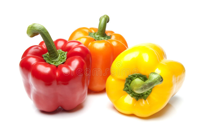 Red Yellow And Orange Bell Peppers On Isolated Whi Royalty Free Stock Photography