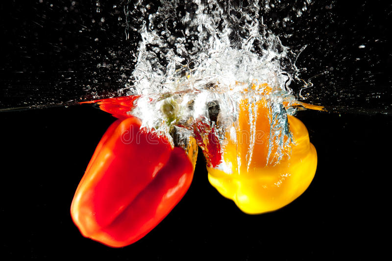 Download Red And Yellow Pepper Water Splash Stock Image - Image of agriculture, speed: 19978247