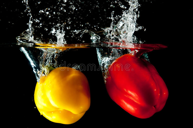 Download Red And Yellow Pepper Water Splash Royalty Free Stock Photography - Image: 19978257