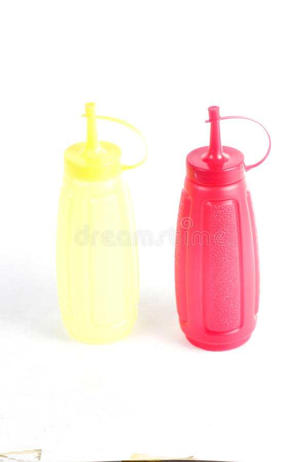 Red and yellow plastic bottle. Isolated on white background royalty free stock photos
