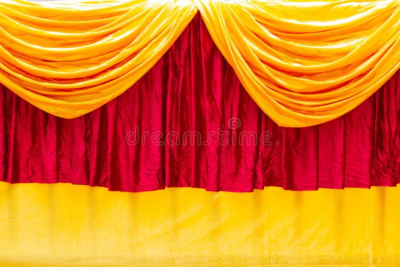 Red and yellow stage theater curtain as a background.  royalty free stock photos