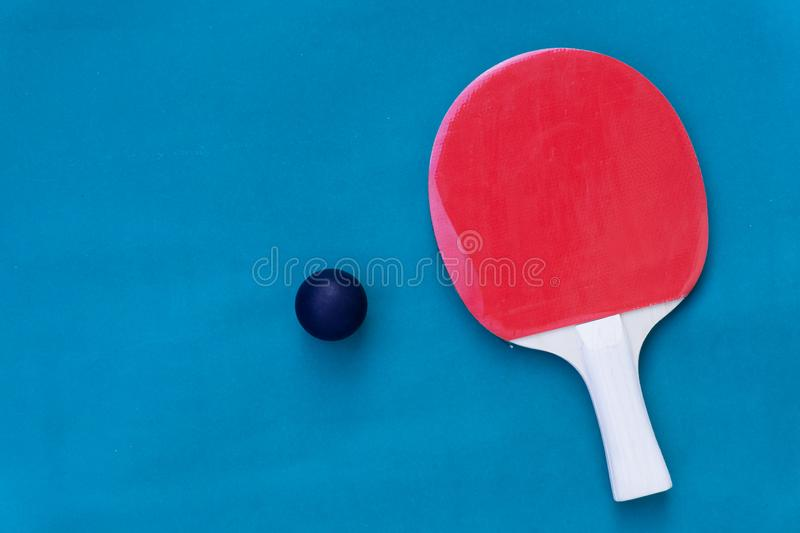 Red and yellow table tennis rackets with black balls,.table tennis rackets and balls on table. Red and yellow table tennis rackets with black balls,table tennis royalty free stock image