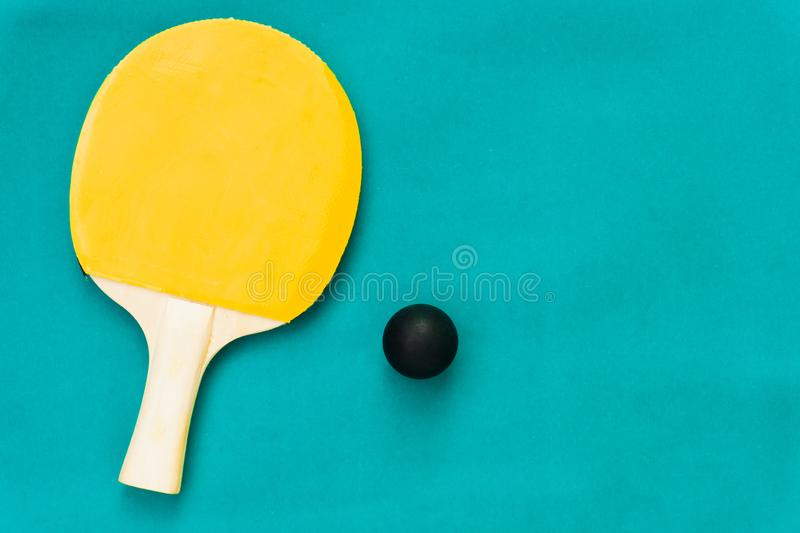 Red and yellow table tennis rackets with black balls,.table tennis rackets and balls on table. Red and yellow table tennis rackets with black balls,table tennis stock photo