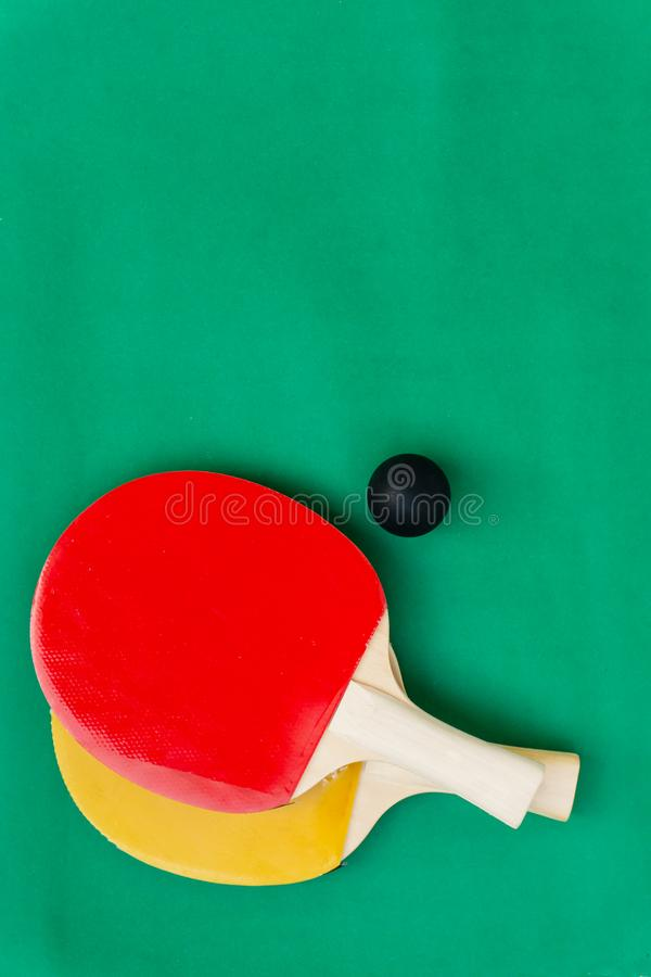 Red and yellow table tennis rackets with black balls,.table tennis rackets and balls on table. Red and yellow table tennis rackets with black balls,table tennis stock image