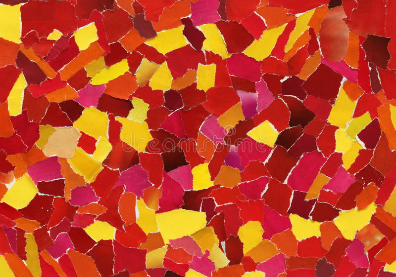 Red and yellow texture of torn paper. Red and yellow texture made from many pieces of torn paper stock photo