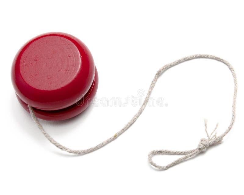 Red Yo-yo. A red yo-yo yoyo with string on white