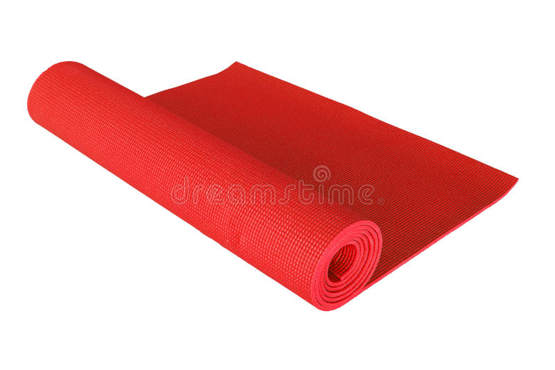 Red yoga mat isolated on white. The red yoga mat isolated on white royalty free stock photos