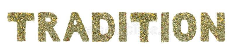 Redacte la TRADICIÓN explicada con las hierbas y las hojas de té foto de archivo libre de regalías