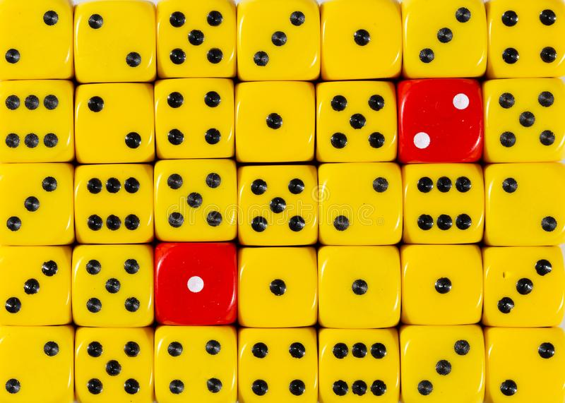 RedBackground of random ordered yellow dices with two red cubes. Pattern background of random ordered yellow dices with two red cubes stock images