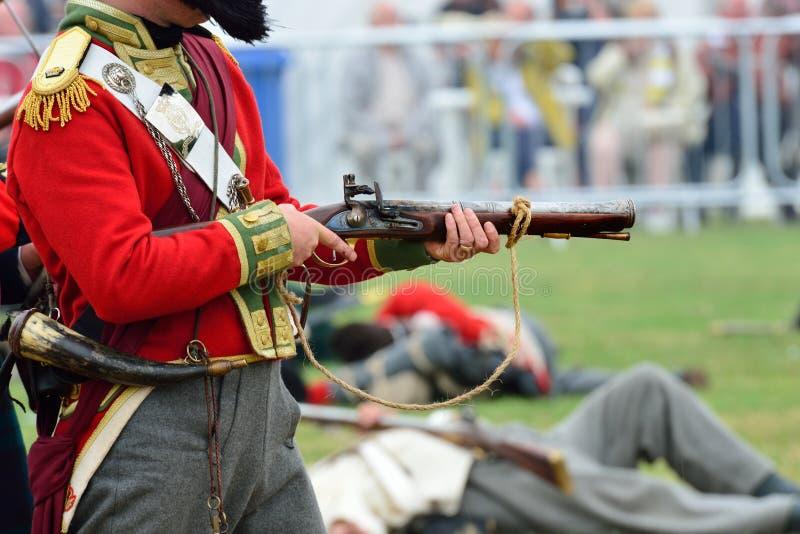 Redcoatzündung Muskete in der Wiederinkraftsetzung stockbild