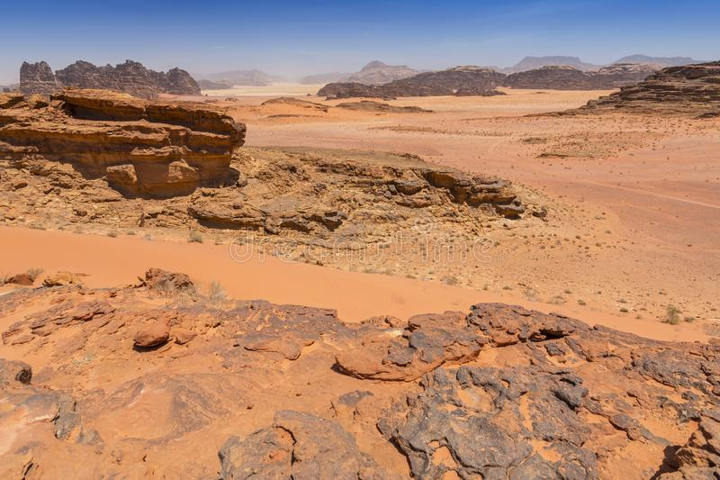 Reddish sand and rock landscapes in the desert of Wadi Rum, southern Jordan royalty free stock image